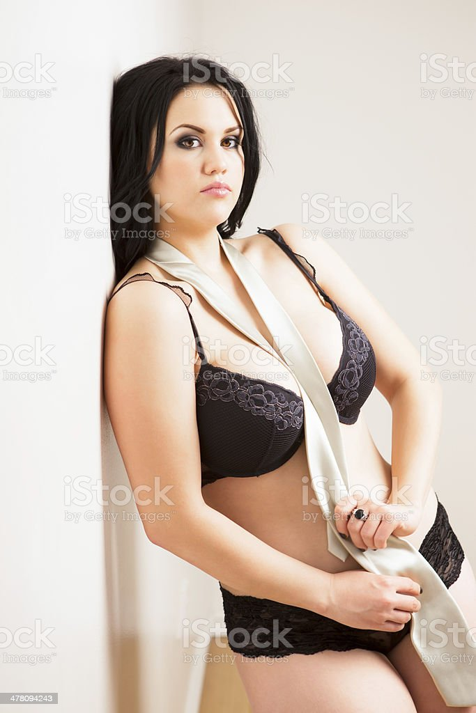 Beautiful woman in lingerie and tie royalty-free stock photo