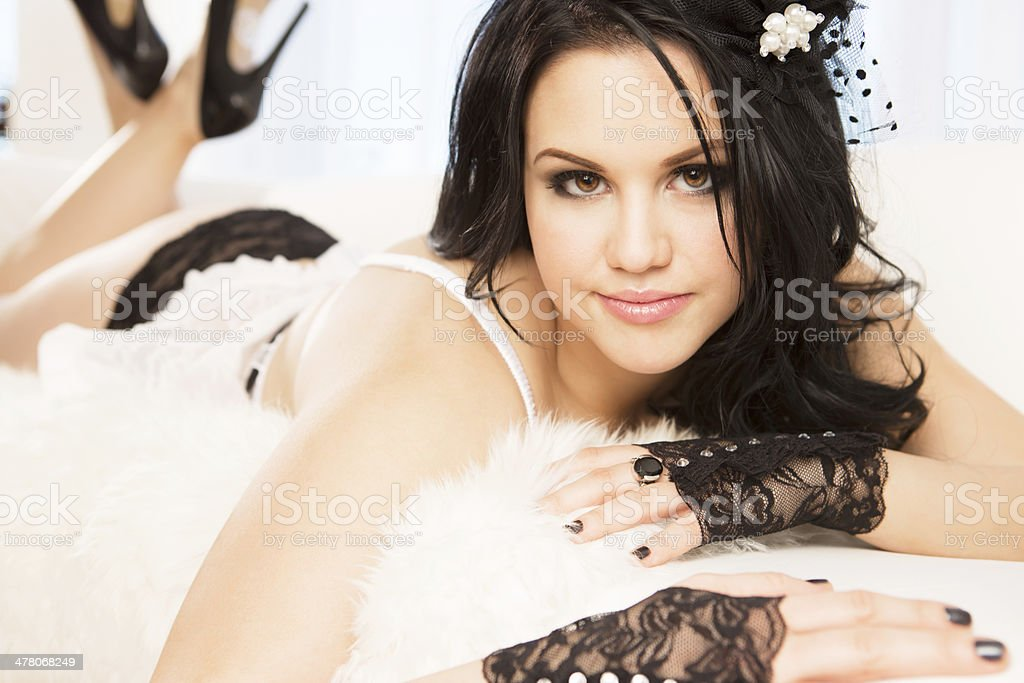 Beautiful woman in lingerie laying on couch royalty-free stock photo
