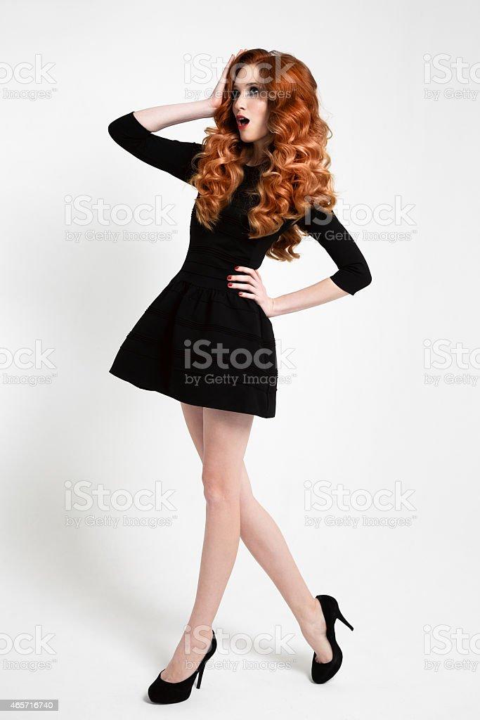 Beautiful Woman in Little Black Fashion Dress. stock photo