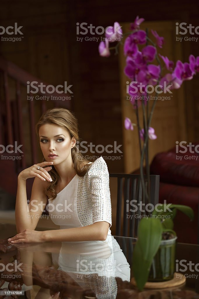 Beautiful woman in living room royalty-free stock photo