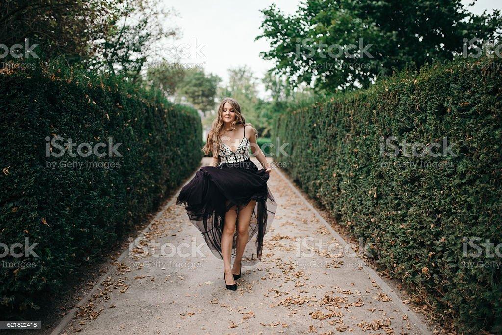 beautiful woman in long black evening dress stock photo