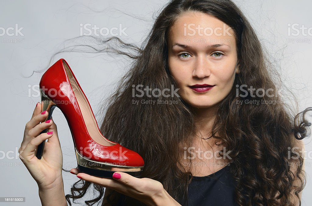 Beautiful woman in love with her high heels shoes royalty-free stock photo