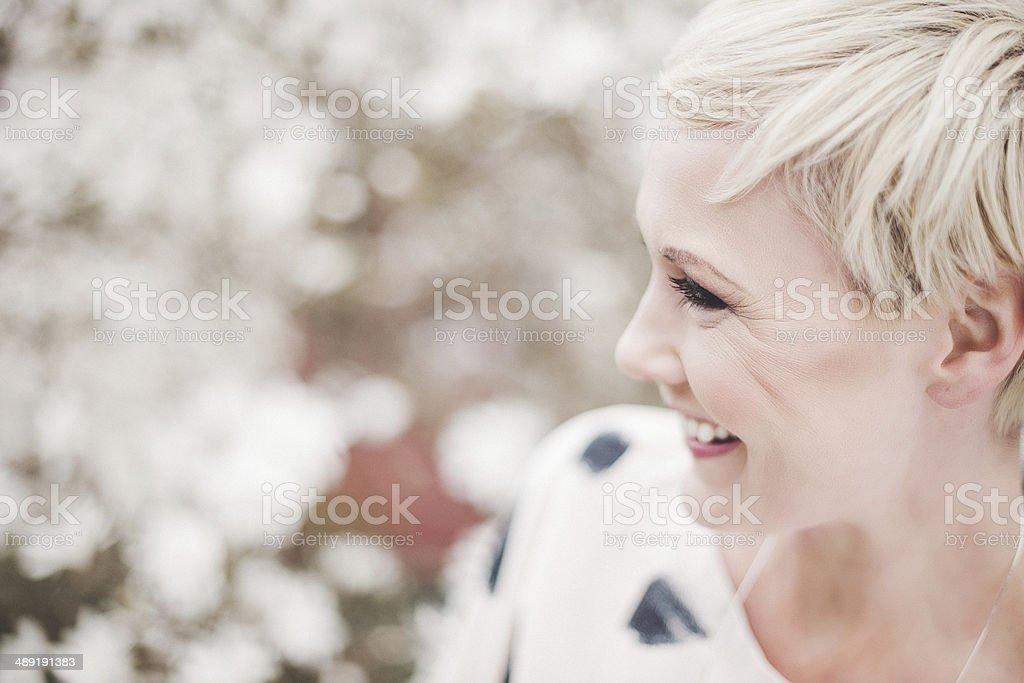 Beautiful woman in magnolia stock photo