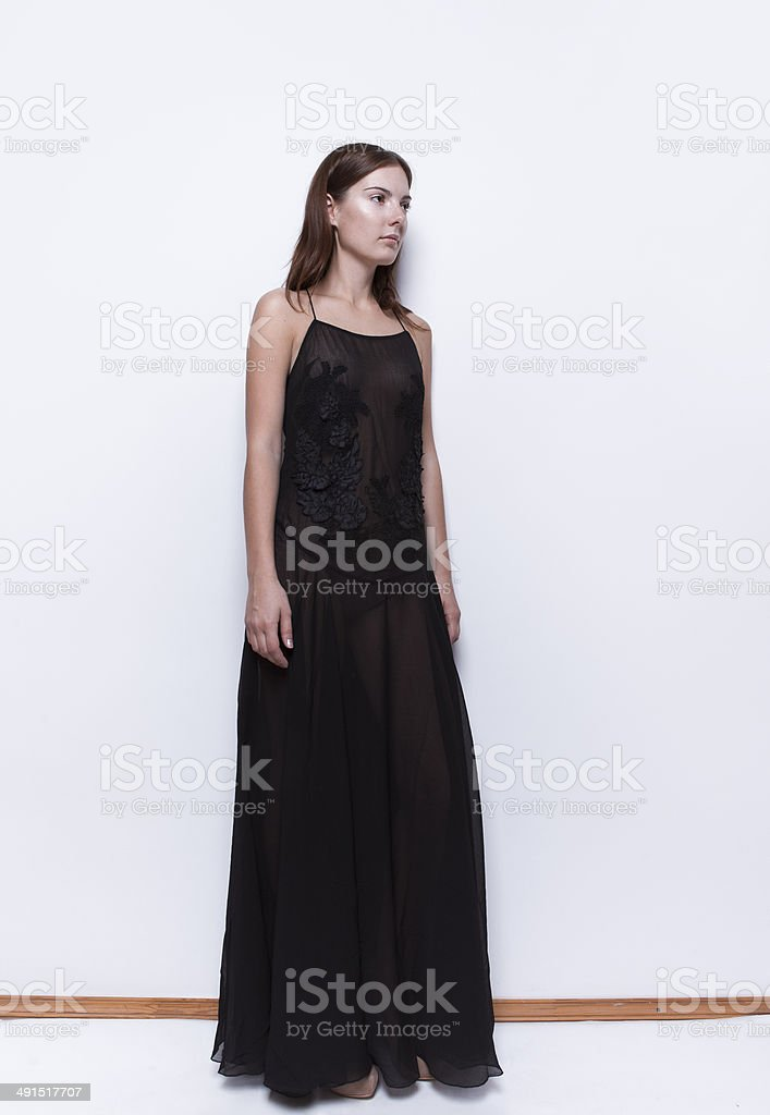 Beautiful woman in maxi dress stock photo
