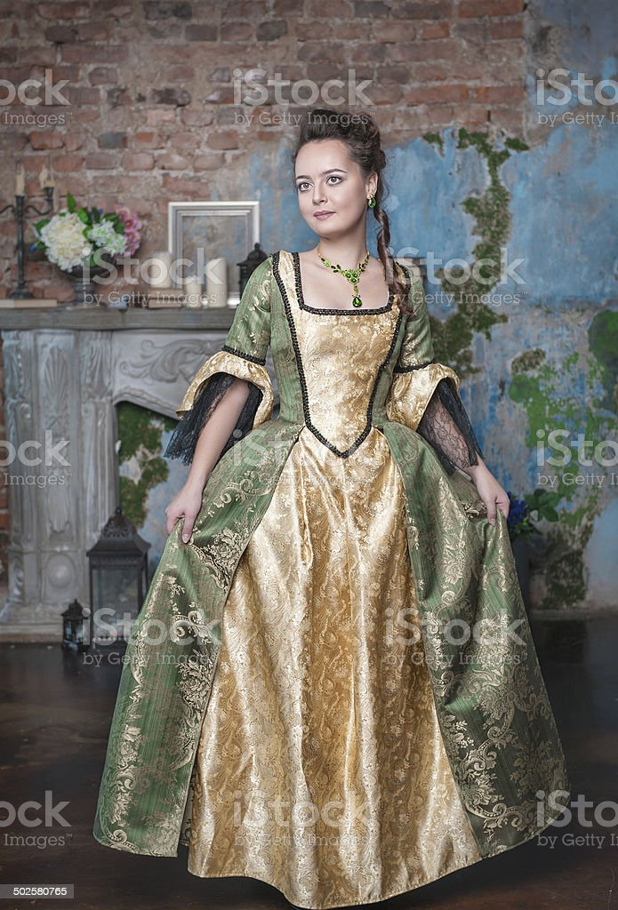 Beautiful woman in medieval dress stock photo
