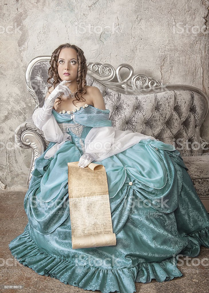 Beautiful woman in medieval dress with scroll letter stock photo