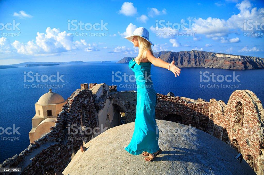 Beautiful Woman in  Oia, Santorini, Greece. stock photo