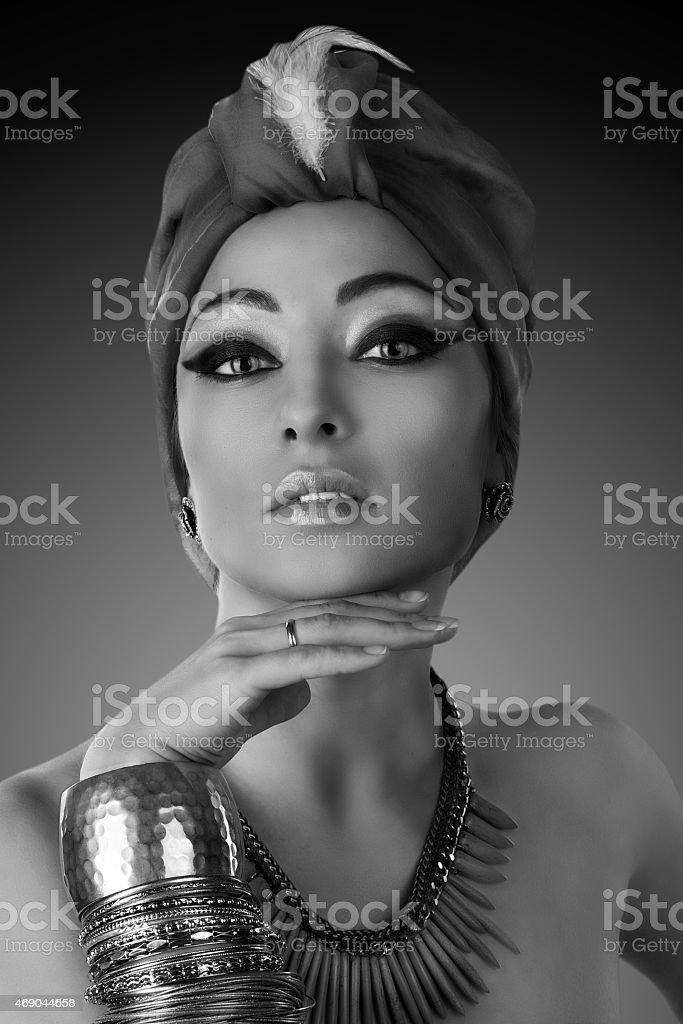 beautiful woman in oriental style in turban stock photo