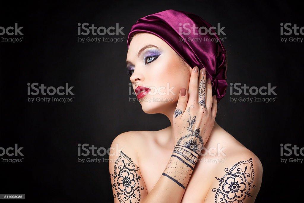 beautiful woman in oriental style with mehendi in hijab stock photo