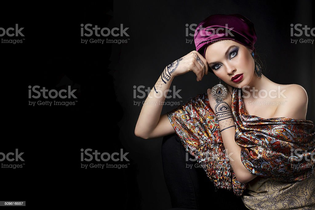 beautiful woman in oriental style with mehendi praying stock photo