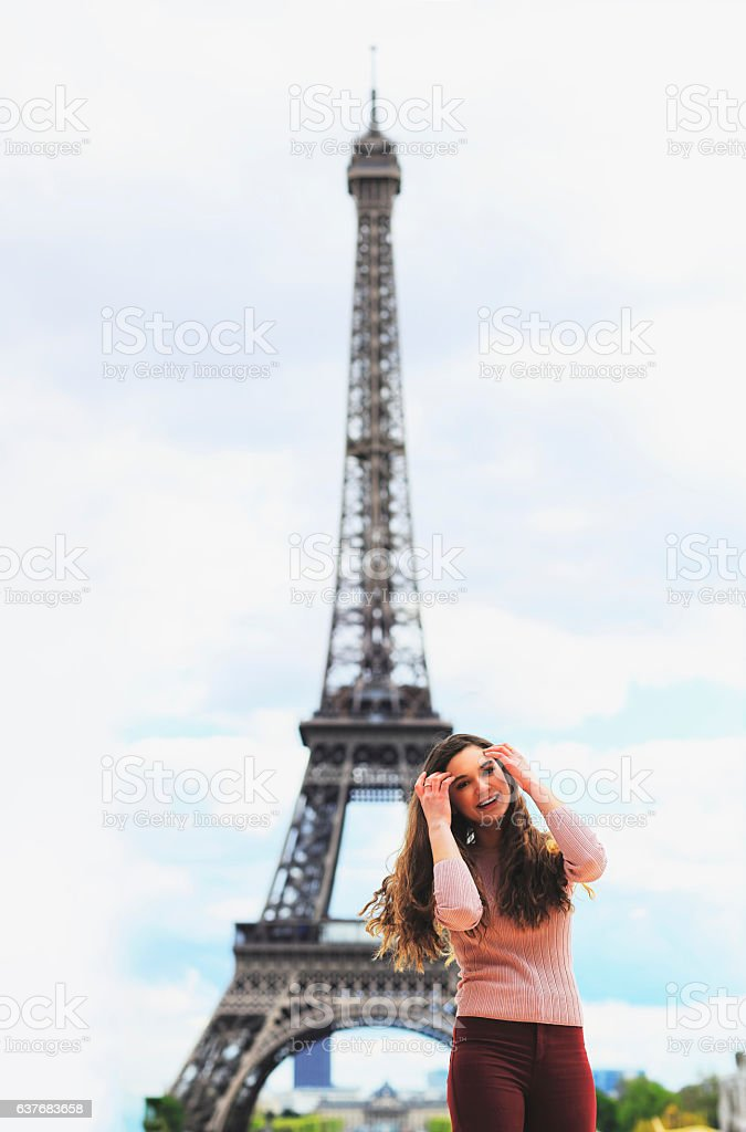 Beautiful woman in Paris near the Eiffel tower stock photo
