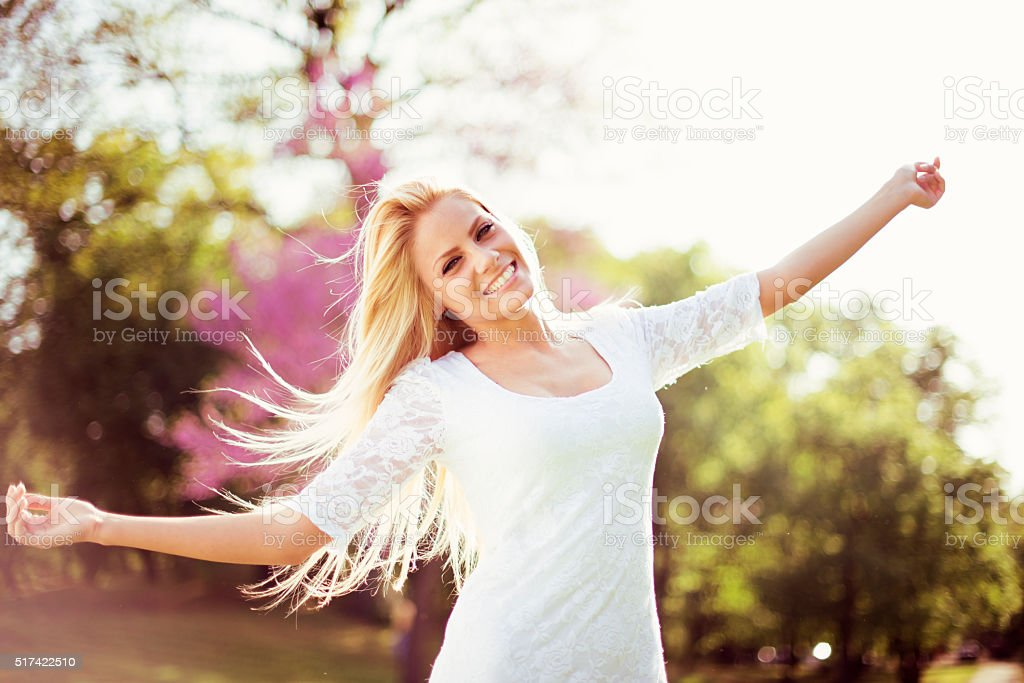 Beautiful woman in park stock photo