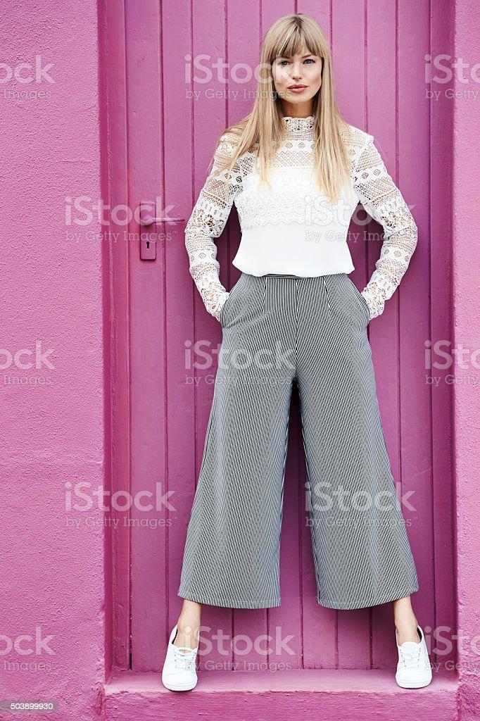 Beautiful woman in pink doorway stock photo