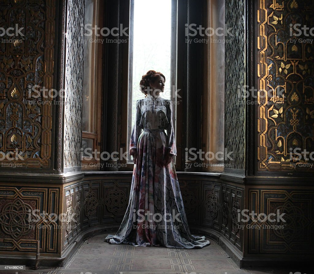 beautiful woman in pink dress stock photo