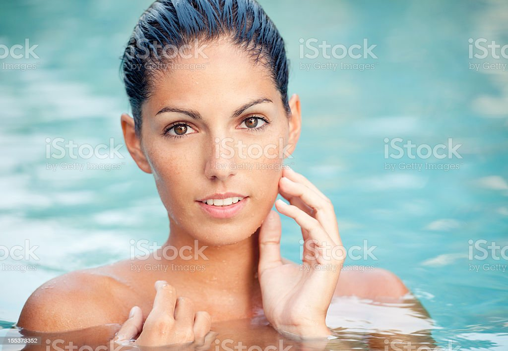 Beautiful Woman in Pool at Sunset royalty-free stock photo