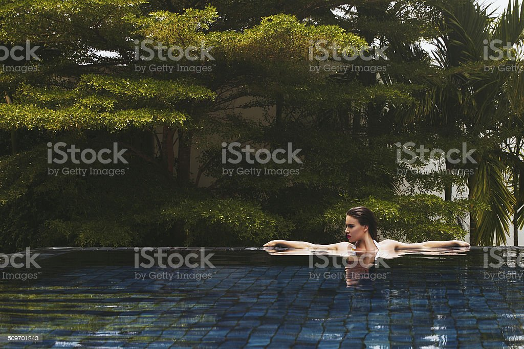 Beautiful woman in pool stock photo
