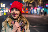 Beautiful woman in red beanie hat in the winter park.