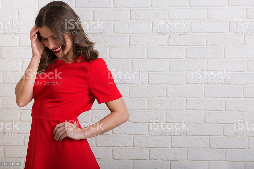 Beautiful woman in red dress stock photo