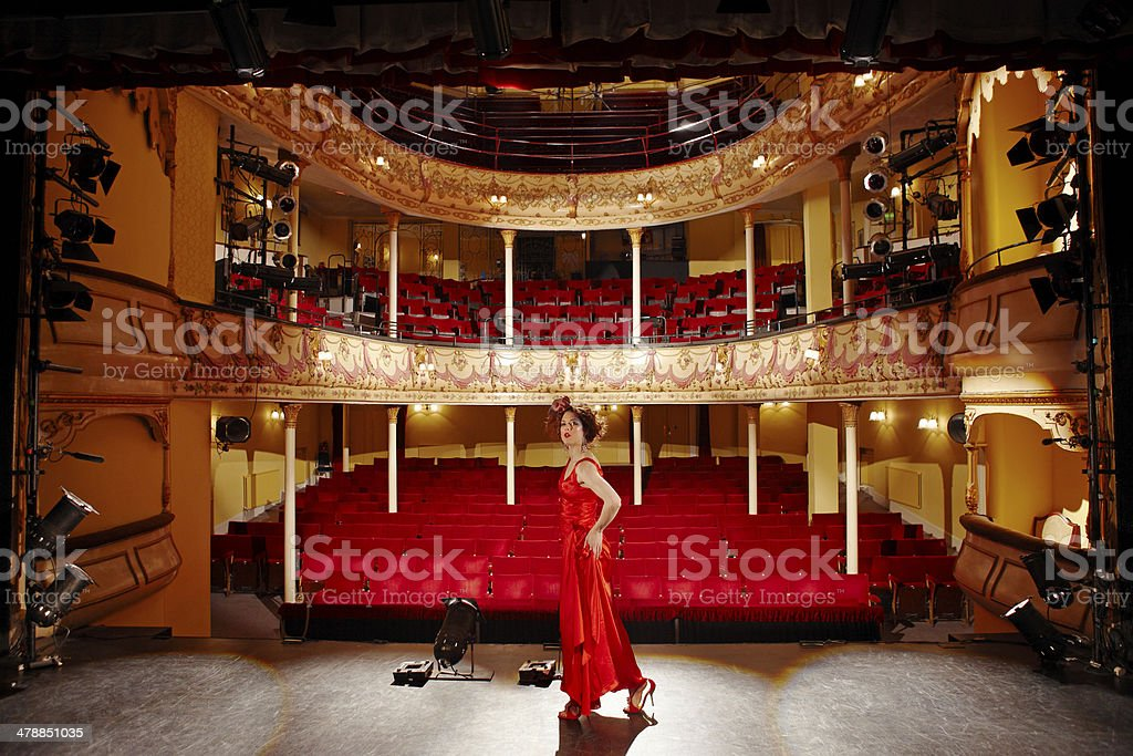 Beautiful Woman In Red Gown On Stage stock photo