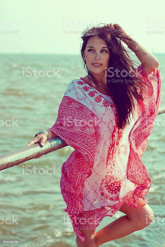 Beautiful woman in red white tunic stock photo