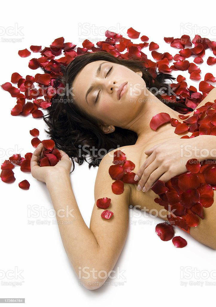 beautiful Woman in Rose Petals royalty-free stock photo