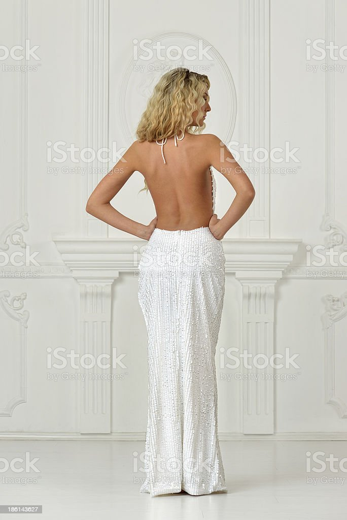 Beautiful woman in sexy  long dress with naked back. royalty-free stock photo