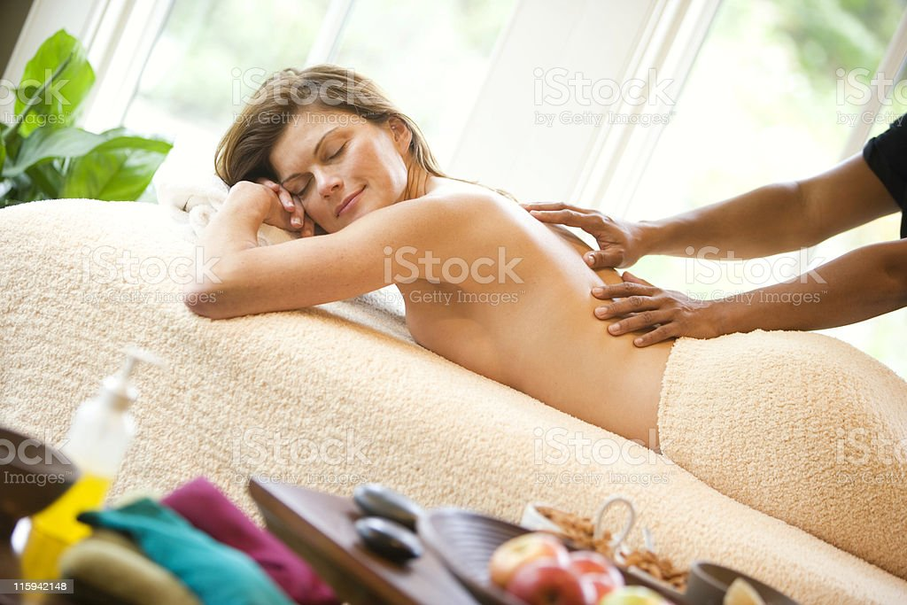 Beautiful Woman in Spa Getting Massage royalty-free stock photo