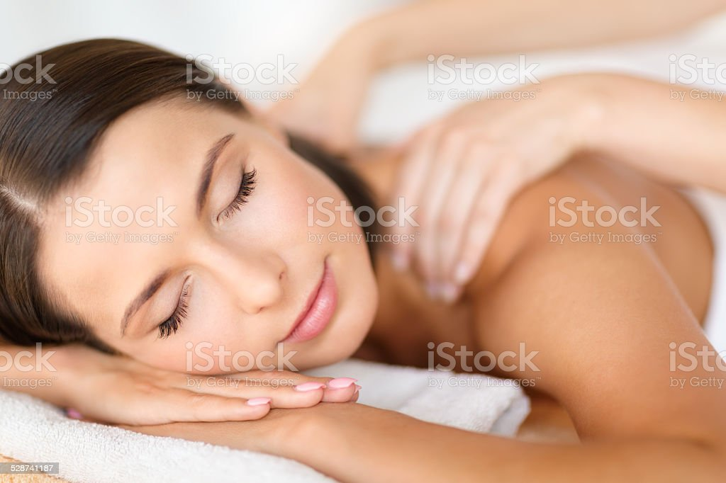 beautiful woman in spa salon getting massage stock photo