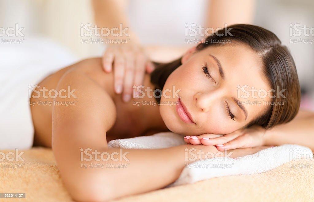 beautiful woman in spa salon getting massage stock photo