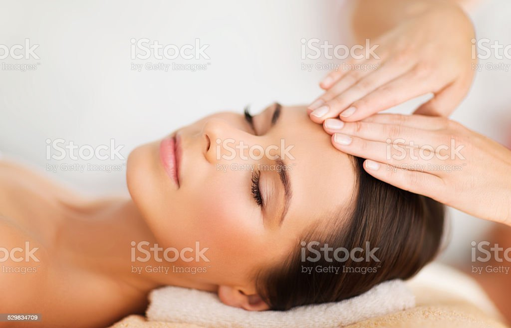 beautiful woman in spa salon having facial stock photo