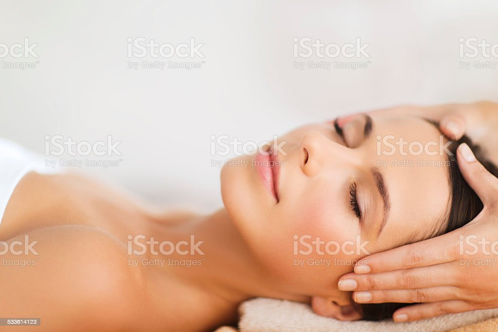 beautiful woman in spa salon having facial stock photo