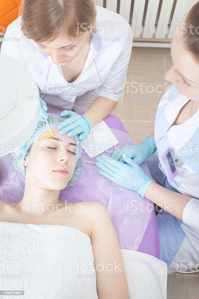 Beautiful woman in spa salon receiving epilation or correction stock photo