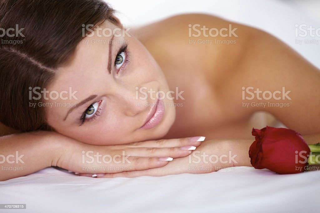Beautiful woman in spa salon with red rose royalty-free stock photo