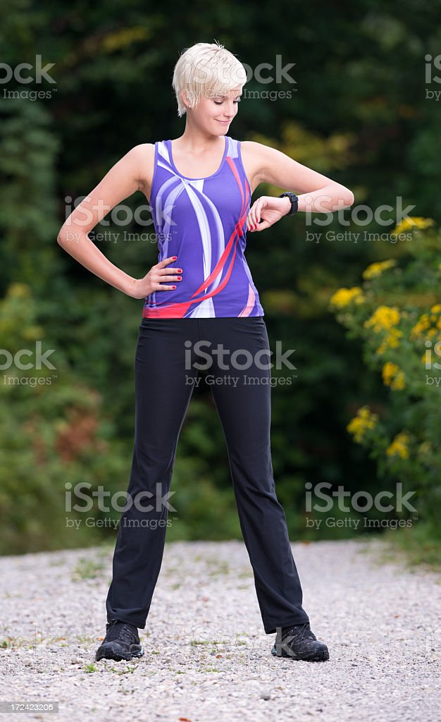 Beautiful Woman in Sport Outfit checking her Time (XXXL) royalty-free stock photo