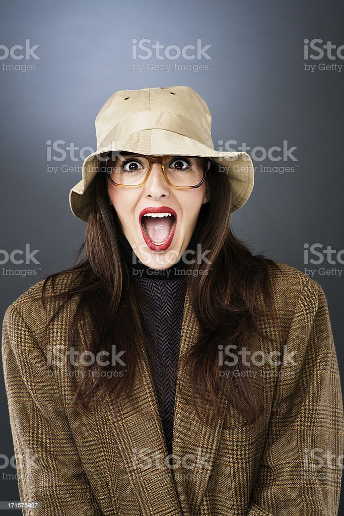 Beautiful woman in strange attire wearing glasses and a hat. royalty-free stock photo