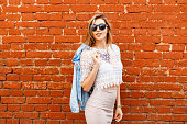Beautiful woman in stylish vintage white blouse with denim jacket.