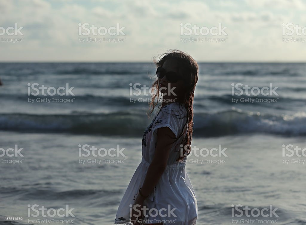 Beautiful woman in summer dress standing stock photo