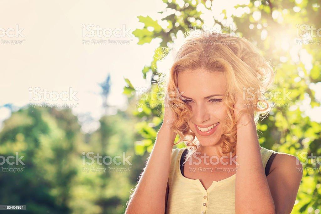 Beautiful woman in summer nature stock photo