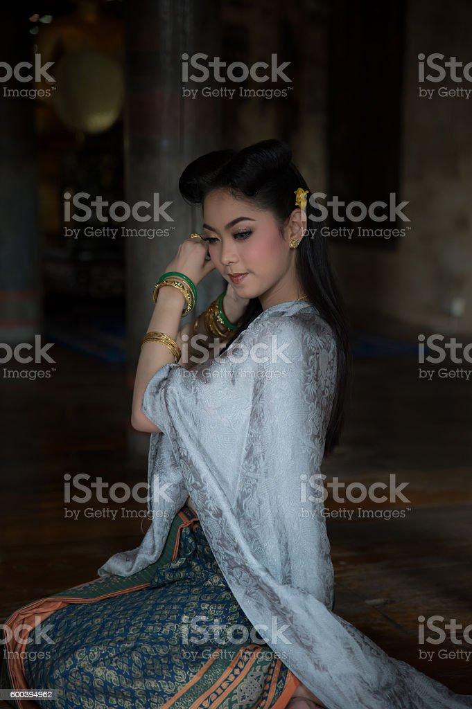Beautiful woman in Thai dress stock photo