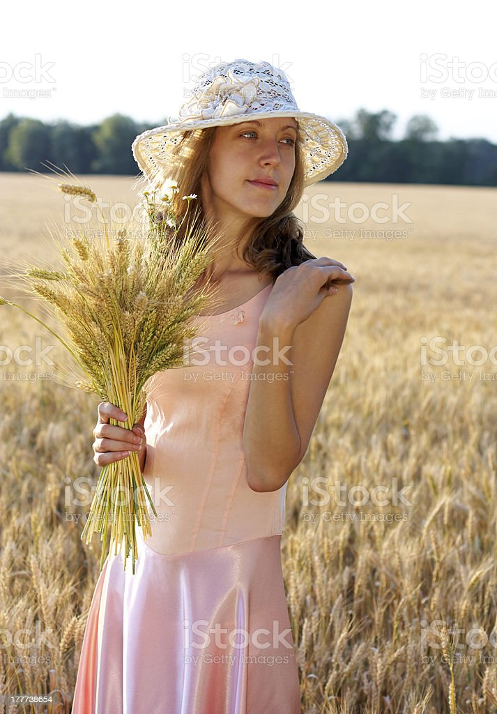 Beautiful woman in the hat hold wheat ears royalty-free stock photo