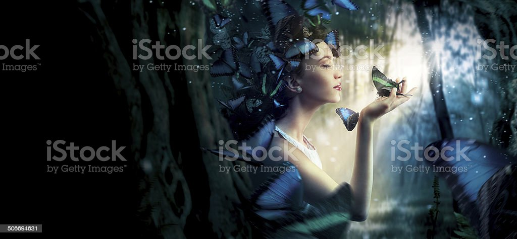 Beautiful woman in the magic forest stock photo