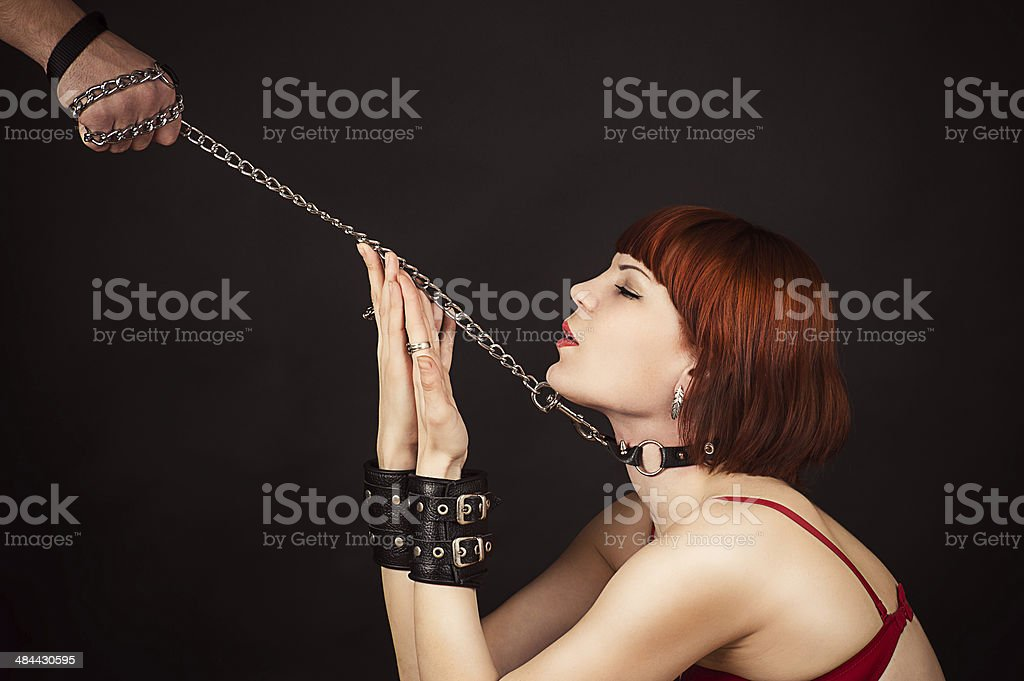 beautiful woman in the role of a slave stock photo