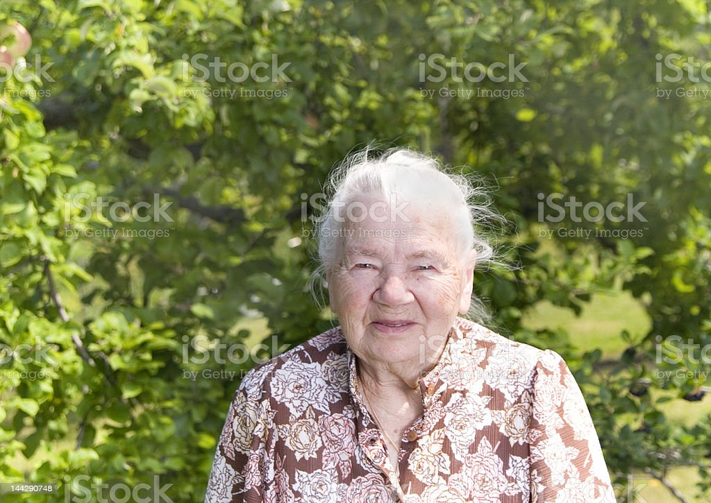 Beautiful woman in the sunny garden royalty-free stock photo