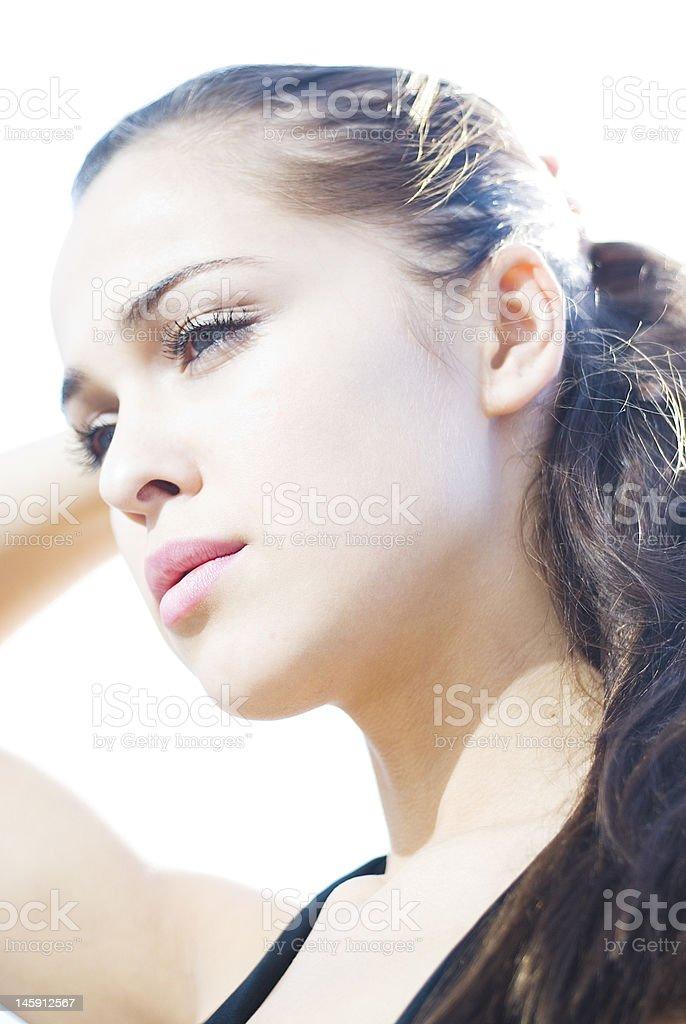 Beautiful woman in the sunshine thinking stock photo