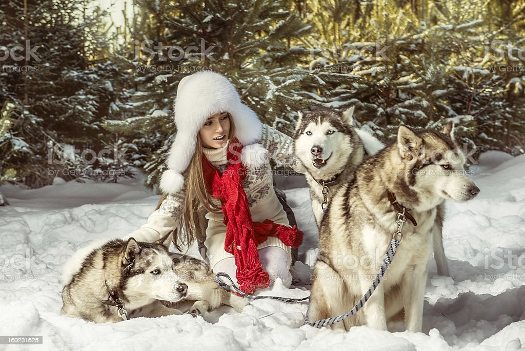 Beautiful woman in the winter forest stock photo