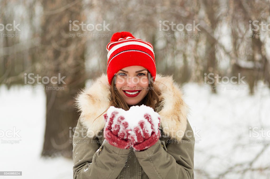 Beautiful woman in the winter park stock photo