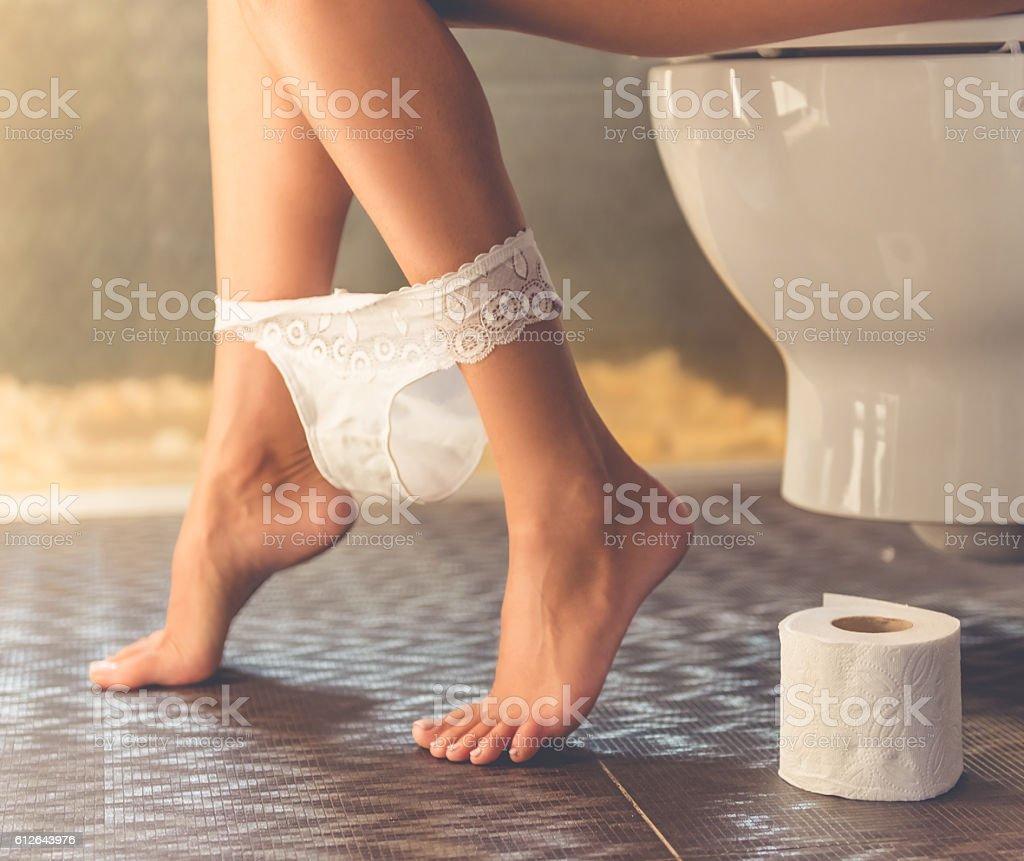 Beautiful woman in toilet stock photo