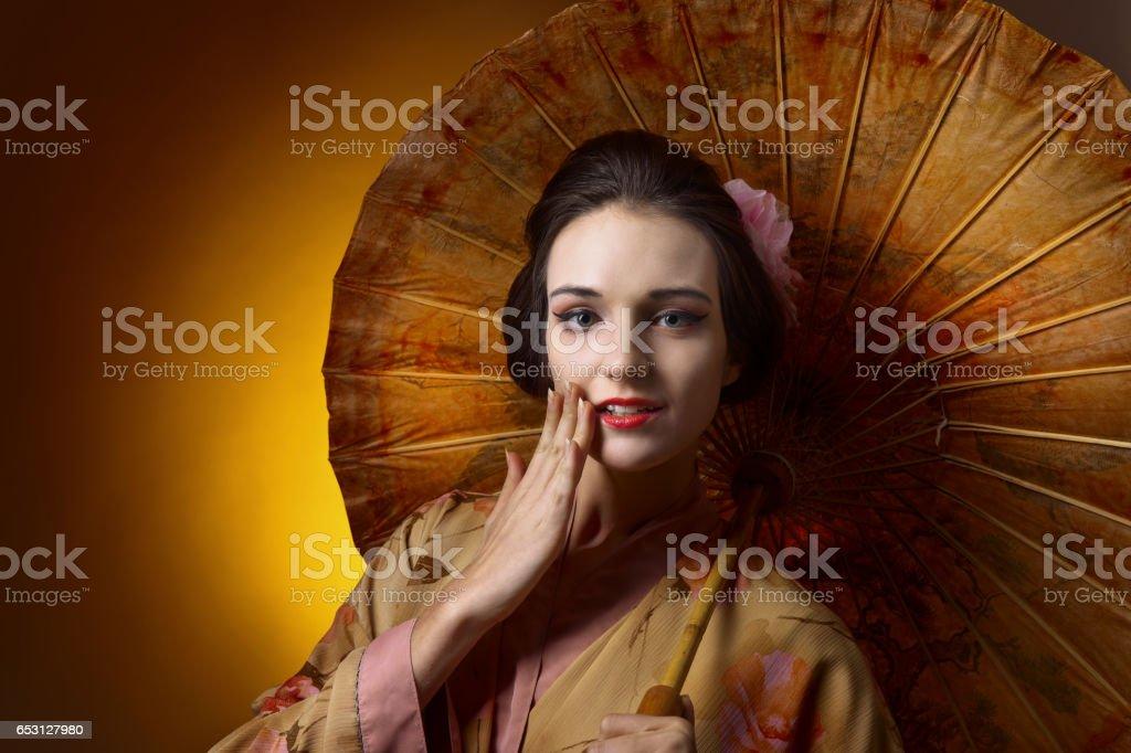 beautiful woman in traditional Japanese kimono with umbrella stock photo