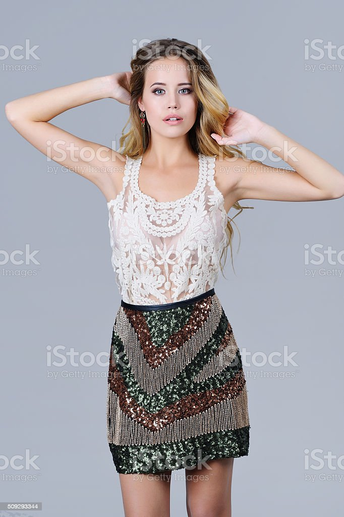 Beautiful woman in trendy sequined skirt stock photo