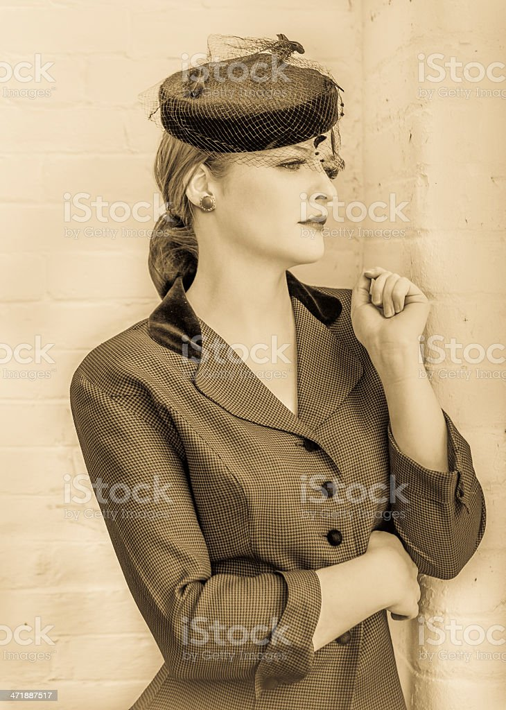 Beautiful woman in vintage forties clothing stock photo